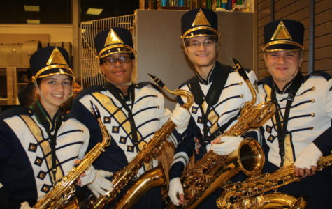 Saxophones get ready before marching onto the field.