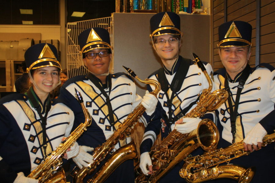 Saxophones+get+ready+before+marching+onto+the+field.