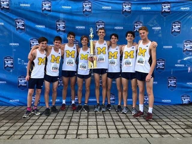 The Midlo Boys celebrate their exciting victory at the Manhattan Cross Country Invitational.