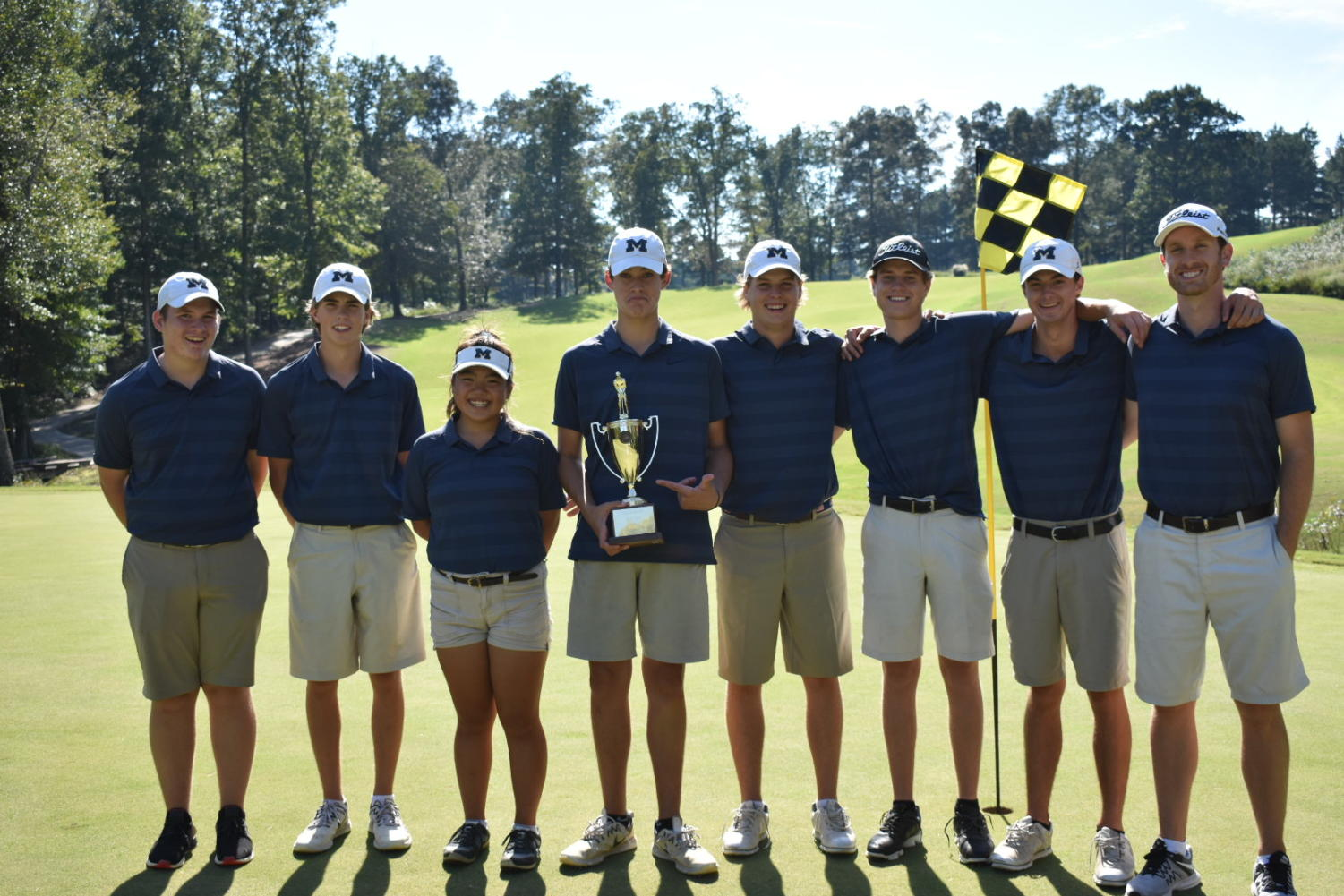 Midlo golf triumphantly celebrates their win in the Regional Tournament.