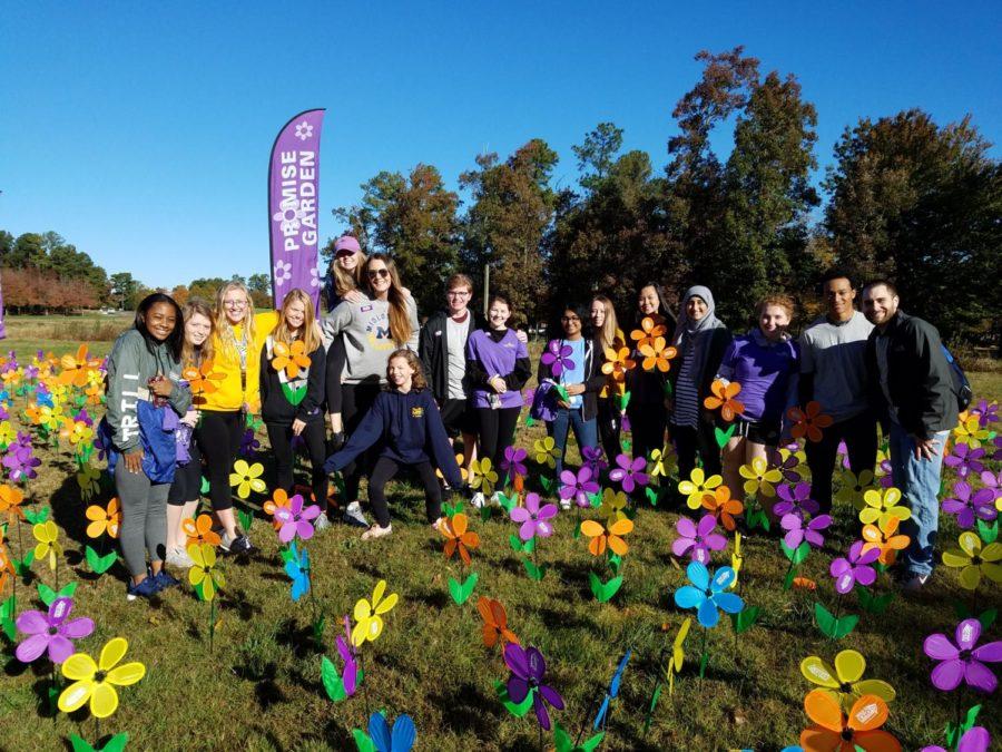 The Alzheimer's and Dementia Awareness Club holds their flowers from the Alzheimer's Association's Flower Garden.