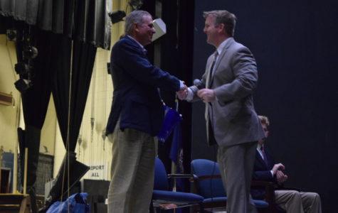 Principal Shawn Abel greets Mr. Doug Pridgen on the stage as he prepares to begin his speech to Midlothian CTE students.
