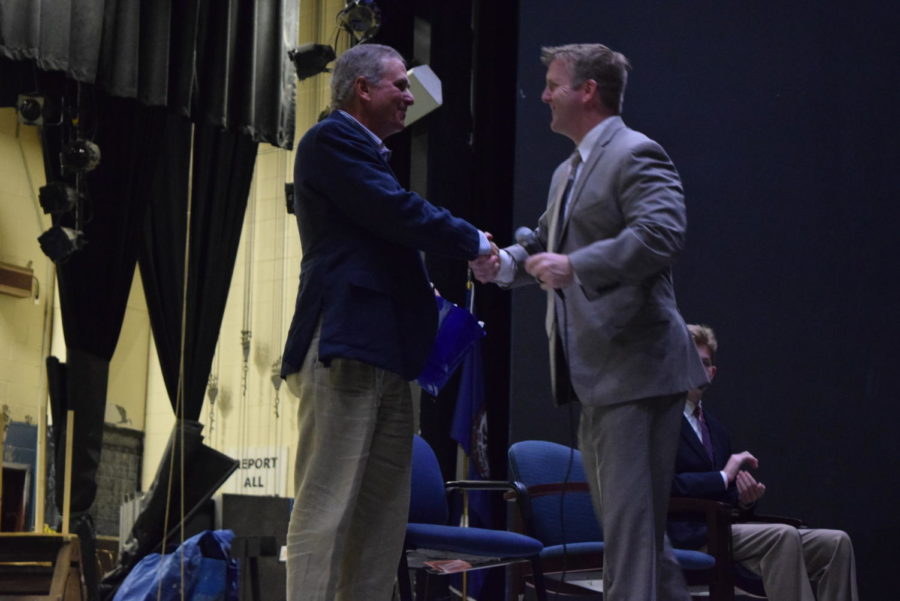 Principal Shawn Abel greets Mr. Doug Pridgen on the stage as he prepares to begin his speech to Midlothian CTE students.