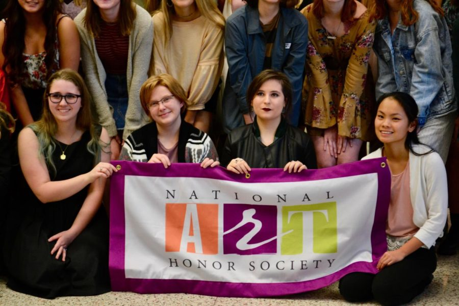 New+NAHS+members+hold+the+society%27s+flag+to+recognize+their+induction+into+the+esteemed+society.