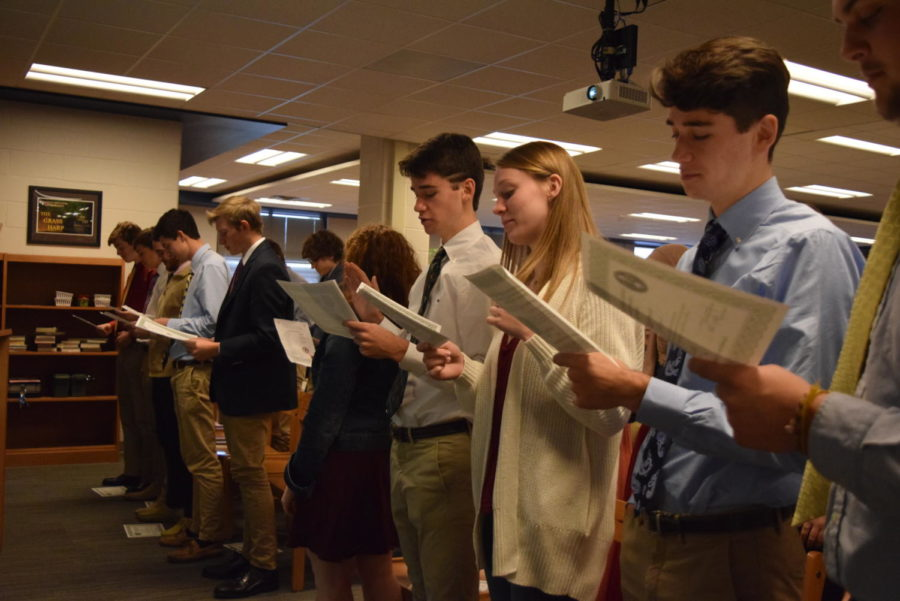 New inductees to National Business Honor Society participate in the induction program.