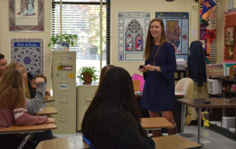 Senior council member Tori Bullis teaches her Trojan Nations group a lesson during homeroom.