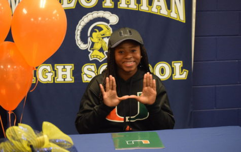 Midlo Senior Taylor Shell signs to play soccer at University of Miami on National Signing Day.