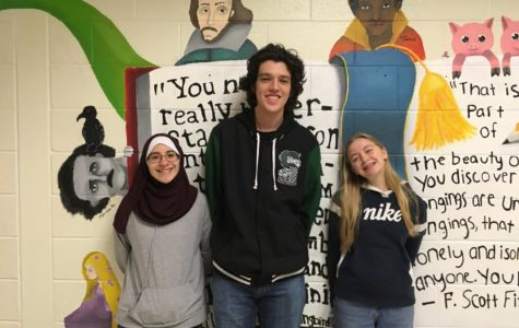 The Writer's Guild officers, Daniel Stein, Britney Price, and Nour Goulmamine, promote their club for the next meeting on November 14th.