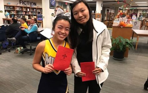 Chloe Naughton and Sherinne Zhang celebrate their induction into the French Honor Society.