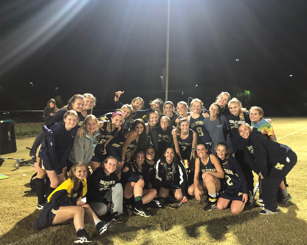 Midlo Field Hockey celebrates a 1-0 win over Powhatan.
