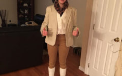 Chloe Martin adorns her costume as Jean-Jacques Rousseau for the Enlightenment PBL.