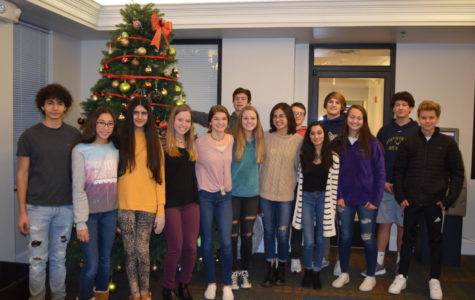The Interact Club travels to the Doorways to spread holiday cheer.