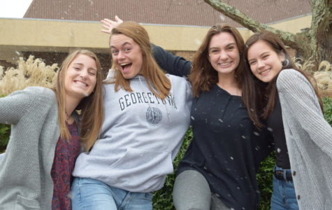 Madeleine Burke, Erin Junkmann, Carrie Rowley, and Caitlin Woods feel excited because snow came during the school day.