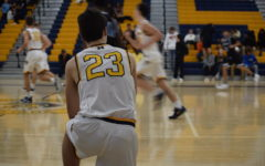 Trojan Boys Basketball Battles Bird