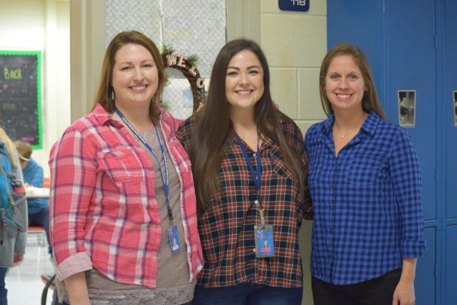 Mrs. Abrahamson, Mrs. Pfund, and Mrs. Fischer sport their favorite flannels for the Teacher Holiday Spirit Week.