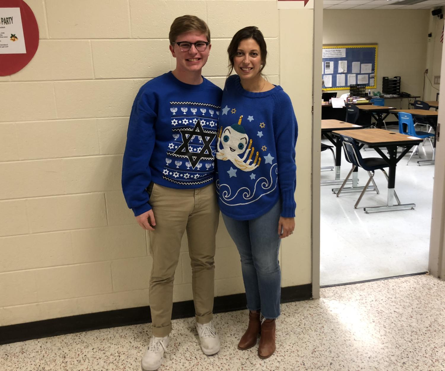 Brent Novey and Mrs. Aiello show off their festive  Hanukkah sweaters.