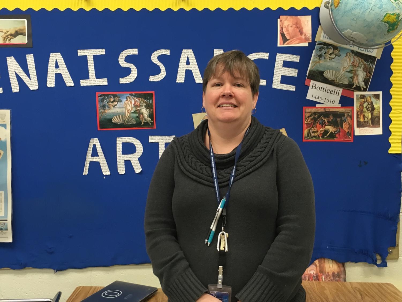 Ms. Heretick receives the December Teachers Recognizing Teachers award from Ms. Bennett.