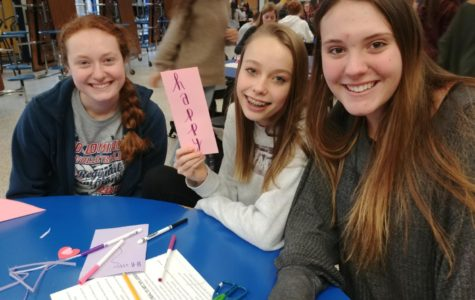 Allison Vonderharr, Victoria Melton, and Mackenzie Sherrod show off their hard work creating Valentine's cards for veterans.