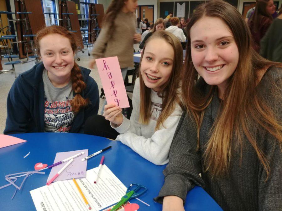 Allison Vonderharr, Victoria Melton, and Mackenzie Sherrod show off their hard work creating Valentine's cards for veterans.