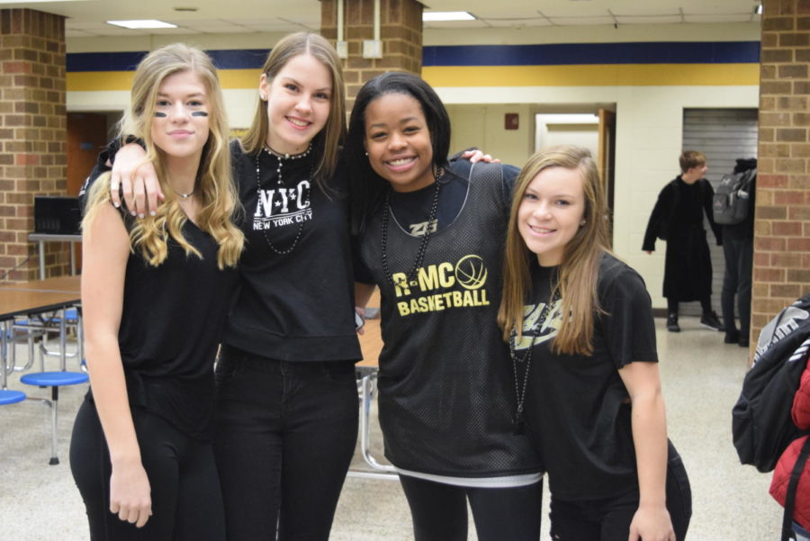 Abby Smith, Olivia Lineweaver, Tiffani Bartee, and Madison Salzmen, prepare for the pep rally by wearing their black attire to support the sophomore class.