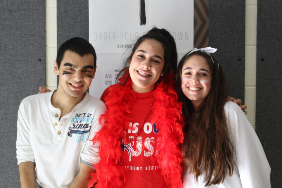 Vinny Biomante, Samantha Boero, and Sophia Nadder prepare for the epic Winter Pep Rally by wearing their class colors.