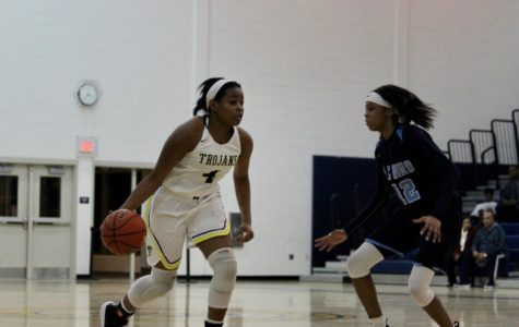 Lady Trojans Basketball Battles Bird