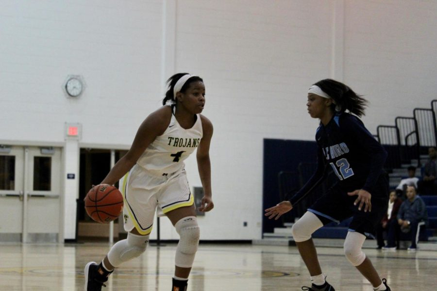 Sophomore Tiffani Bartee initiates a play against L.C. Bird Defender.