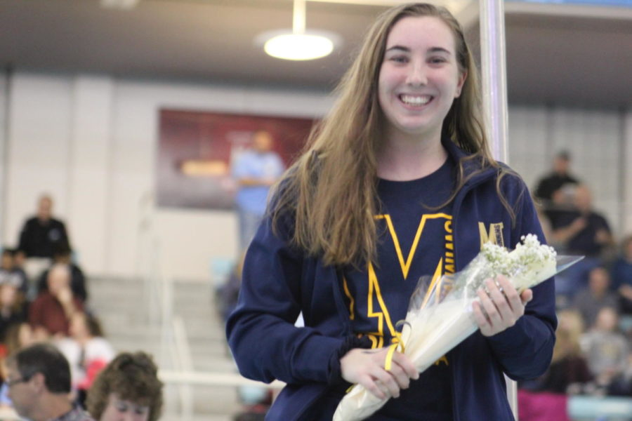 Senior Elizabeth Czenczek, captain of the swim team, is recognized at 2019 Swim Senior Night.
