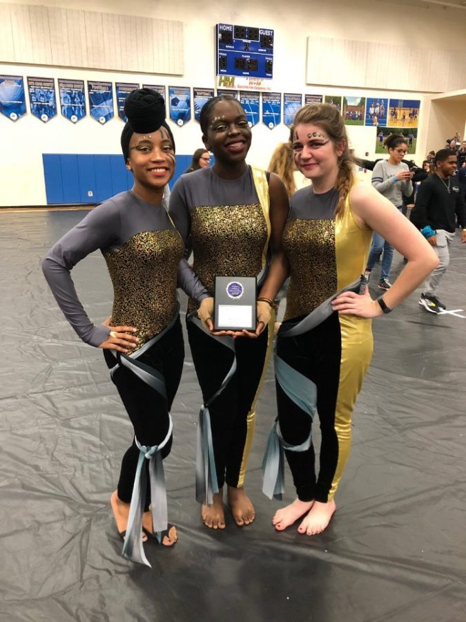 Captains Cameron Lee, Lealauni Gray, and Lexi Labott prepare to compete at the Atlantic Indoor Winter Guard competition.