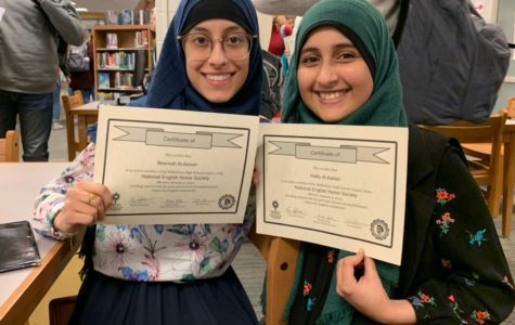 Bessmah Al-Ashari and her sister Haifa Al-Ashari proudly display their award for being newly inducted to the National English Honors Society.