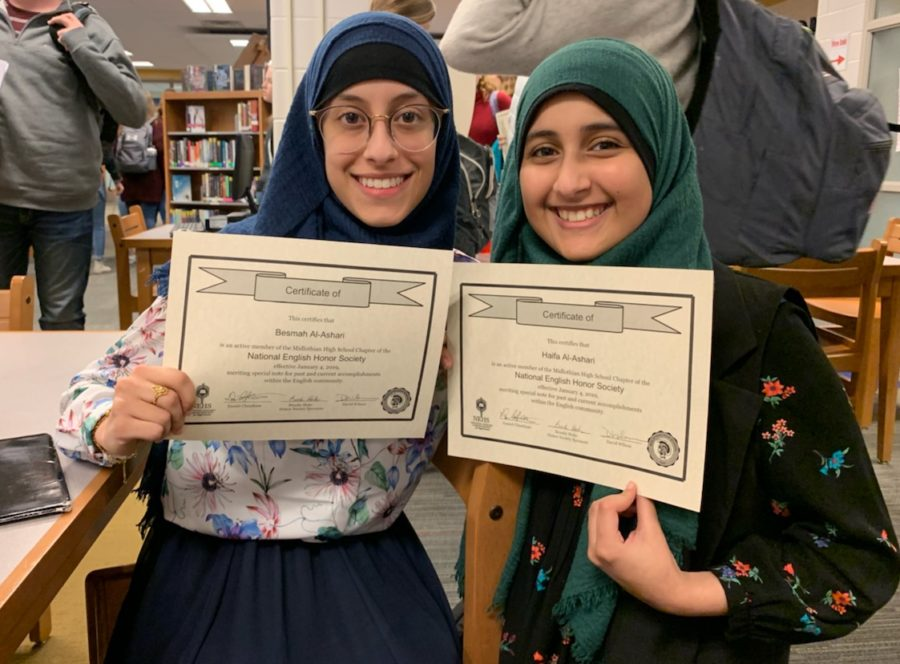 Bessmah+Al-Ashari+and+her+sister+Haifa+Al-Ashari+proudly+display+their+award+for+being+newly+inducted+to+the+National+English+Honors+Society.+