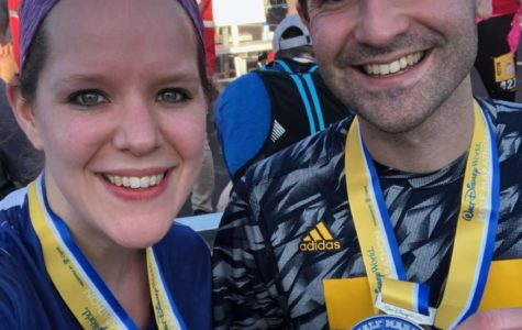 Mr. Anthony Bolton and his wife Ashlyn celebrate their finish after the Walt Disney World Half Marathon in Orlando, Florida.