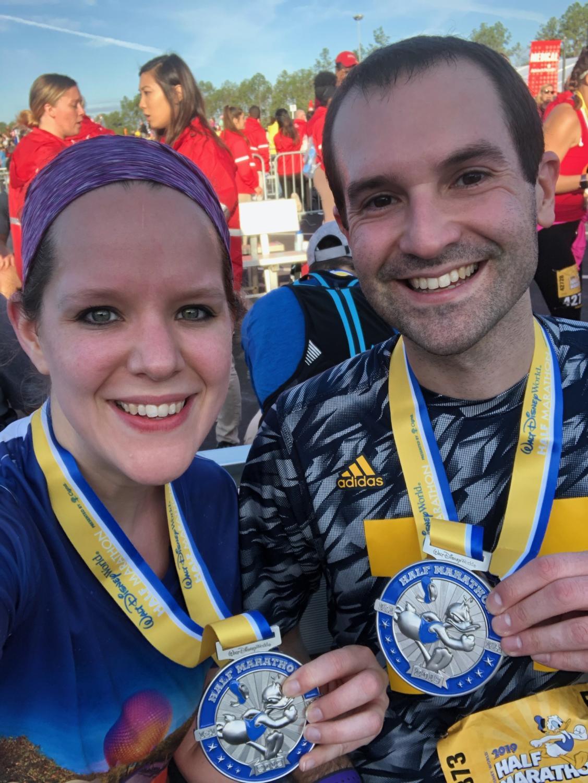 Mr. Anthony Bolton and his wife Ashlyn celebrate their finish after the Walt Disney World Half Marathon in Orlando, Florida.