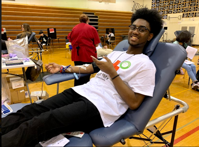 Tray+Davis+relaxes+while+nurses+tend+to+other+donors+during+the+IB+Blood+Drive.