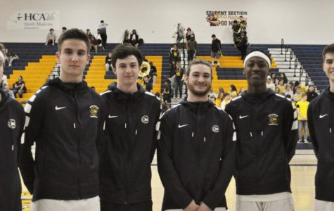 The six Midlo Boys' Basketball seniors celebrate their last home game in a Trojan uniform.