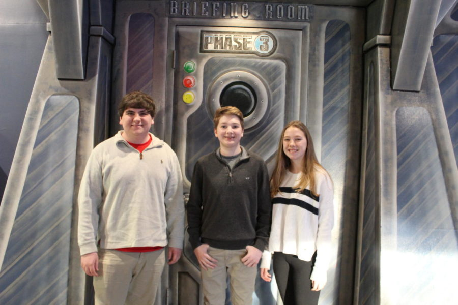 Matthew Suddreth, Gavin Holloway, and Lily Suddreth gathered at LaserQuest in the name of community service, and participated in fundraising for RAMPS.