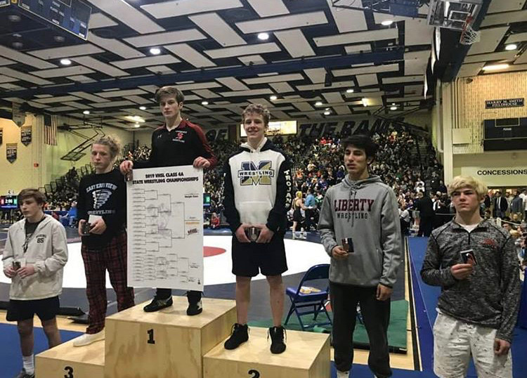 Junior John Bolstad takes second place for weight class 132 at the 2019 States Wrestling Tournament.