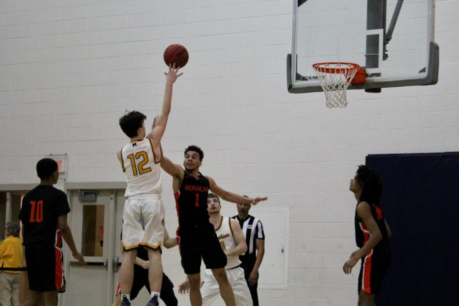 Sophomore Aidan Marsili goes up for a jump shot against the Monacan Chiefs.