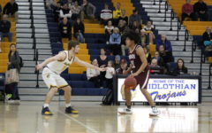 Midlo Basketball Battles Bravely in Regional Matchups