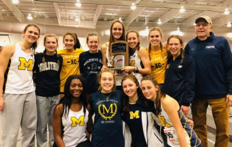 The Midlo Girls and Coach Stan Morgan celebrate their second place finish at the VHSL Indoor Track and Field State Championships at Roanoke College.