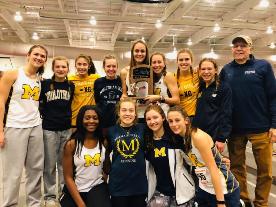 The+Midlo+Girls+and+Coach+Stan+Morgan+celebrate+their+second+place+finish+at+the+VHSL+Indoor+Track+and+Field+State+Championships+at+Roanoke+College.