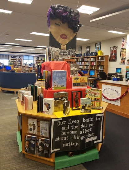 The+Midlo+librarians+create+the+Black+History+month+display+in+the+library.