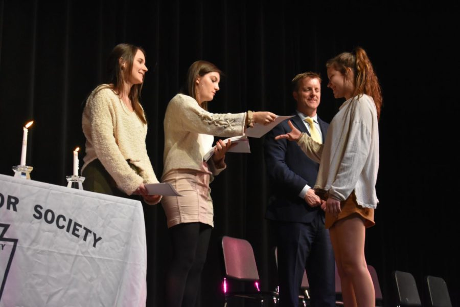 Kathryn Phillips, Kenley Gregory and Principal Abel congratulate new inductee Zoe Kopidis at the NHS Induction.