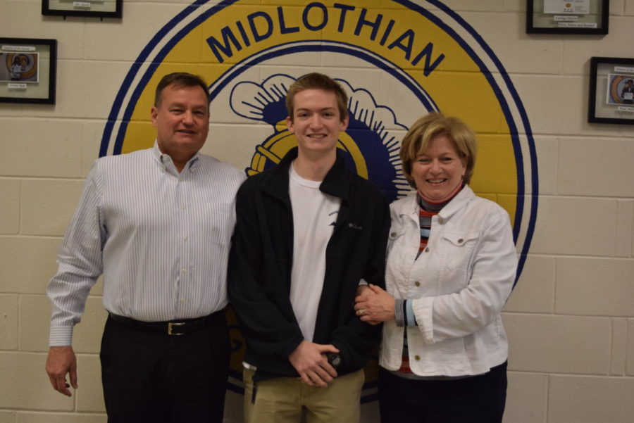 Michael Rowe's family congratulates him on receiving the Student of the Year.