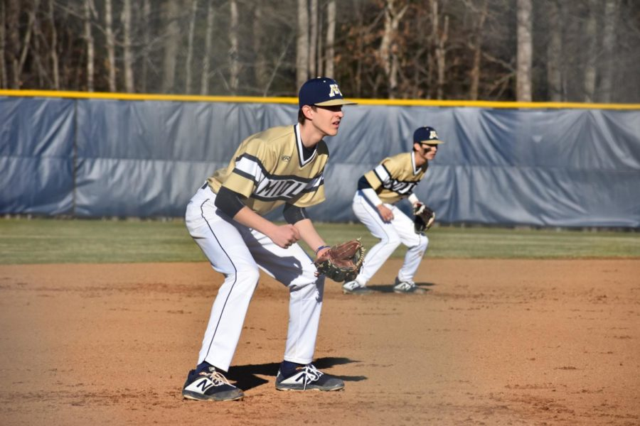 Carter Lovasz and Hunter Beck prepare for the ball to reach the field.
