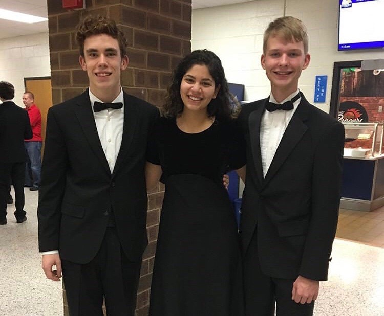 Band students, Dylan Vincent, Alessandra Taliaferro, and Braden Nostheide, wait for the results at the 2019 Band Assessment.