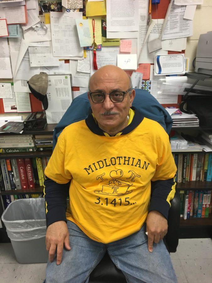 Math teacher, Mr.Sharobim shows off his Pi day t-shirt in celebration.