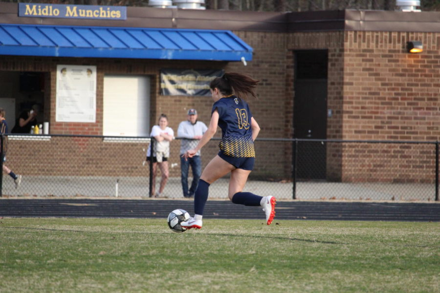 Anna Basir drives up the field against L.C. Bird.