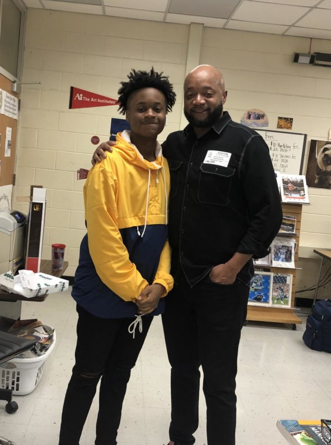 Midlo sophomore Kaden Brown spends time with his father, Mr. James Brown, Def Jam Recordings Vice President of Urban Promotions, after he spoke to Mrs. Manheim's class.