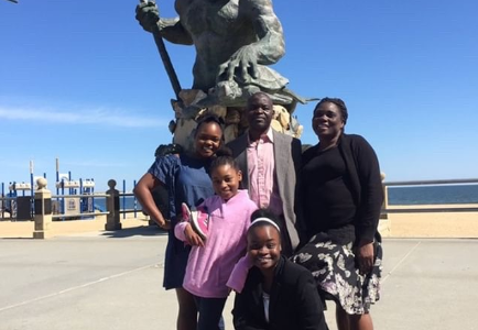 Vongai Zhandira celebrates gaining her citizenship with her family in Virginia Beach.